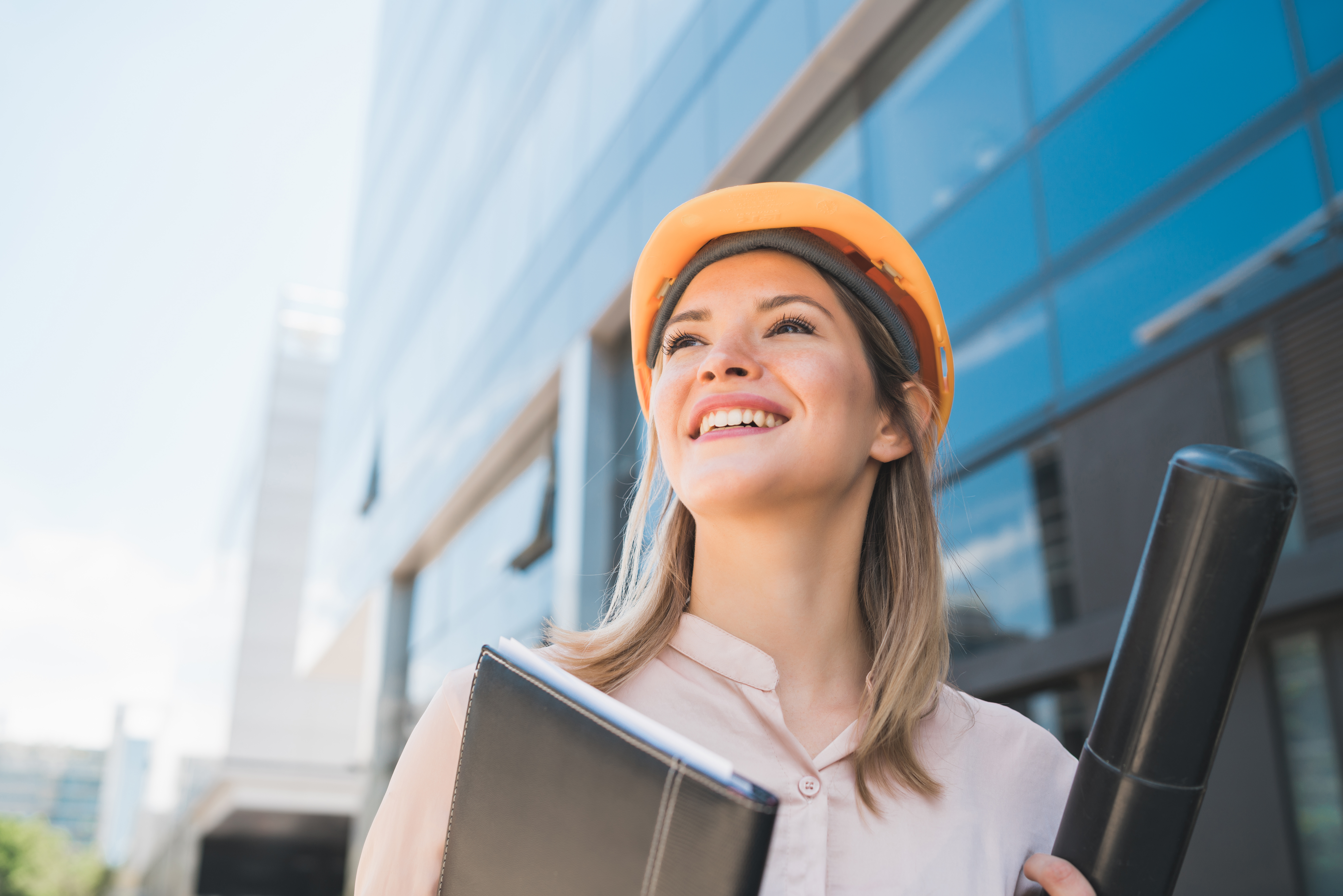 portrait-professional-architect-woman-wearing-yellow-helmet-standing-outdoors-engineer-architect-concept